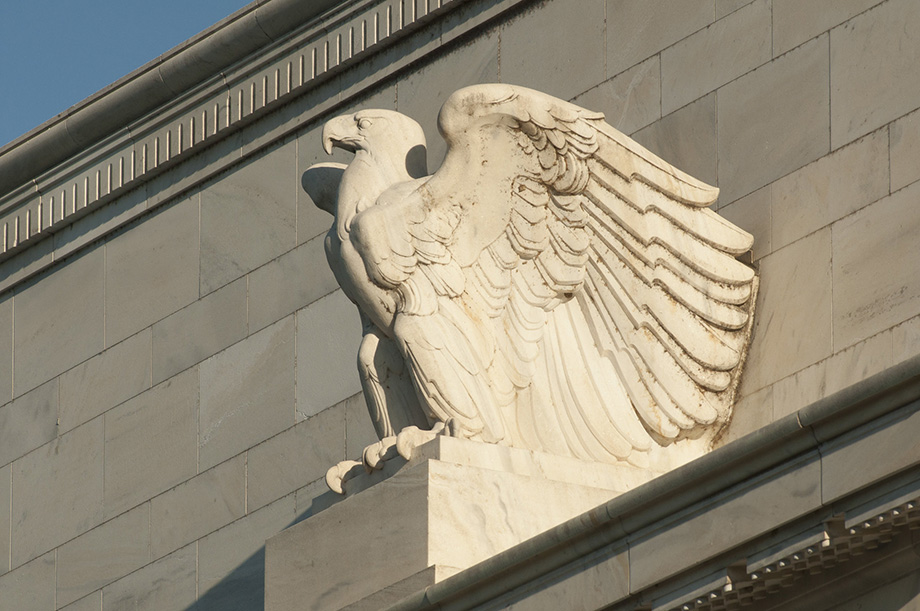 An eagle statue adorns the Marriner S. Eccles Federal Reserve Board Building in Washington, D.C.